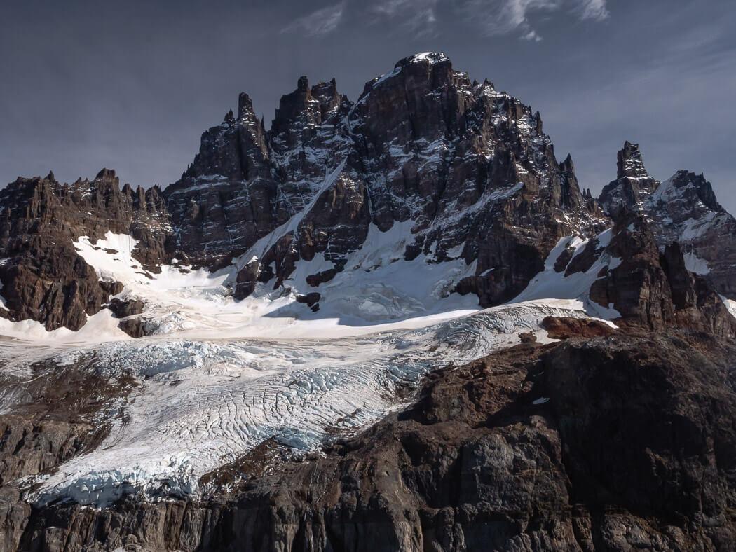 The sharp peaks of Cordillera Cerro Castillo with blue sky in the background