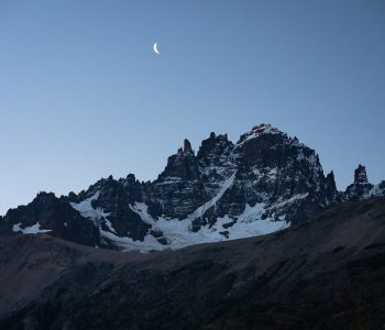 A crescent moon over the Cerro Castillo range
