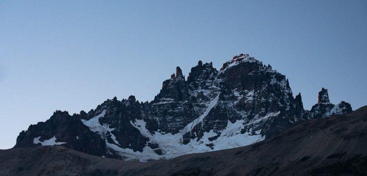 A crescent moon over the Cerro Castillo range