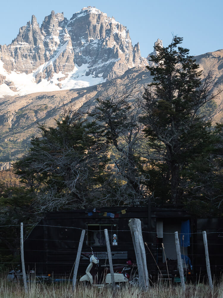 An old vespa with Cerro Castillo in the background