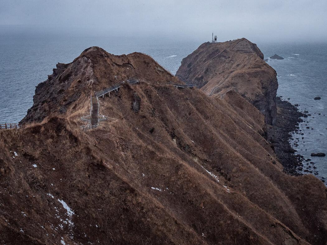 Cape Kamui with moody skies and baren terain
