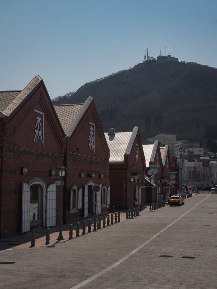 The red brick warehouse buildings leading up to Mt Hakodate