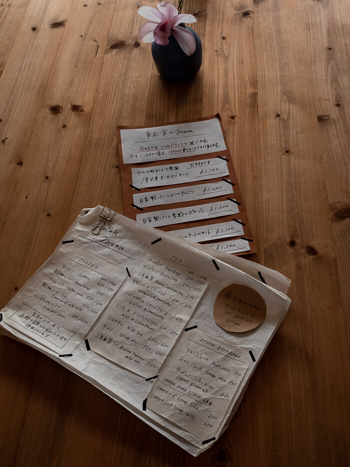The menu on a wooden table in Cafe Classic