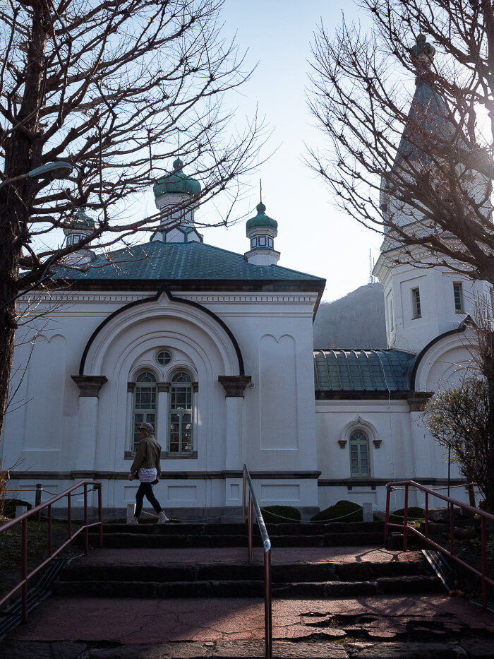 A girl walks in from of an orthodox church, Hakodate