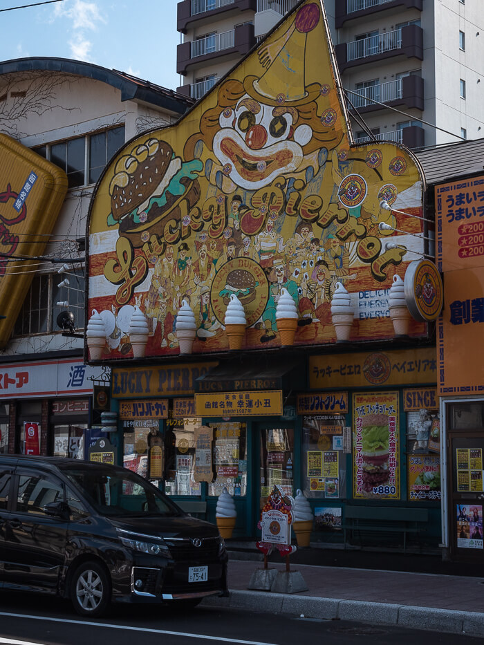 The Lucky Pierrot sign above the store on the street