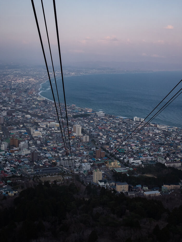 A scenic journey up the Hakodate Ropeway, with the sea and dusk colours