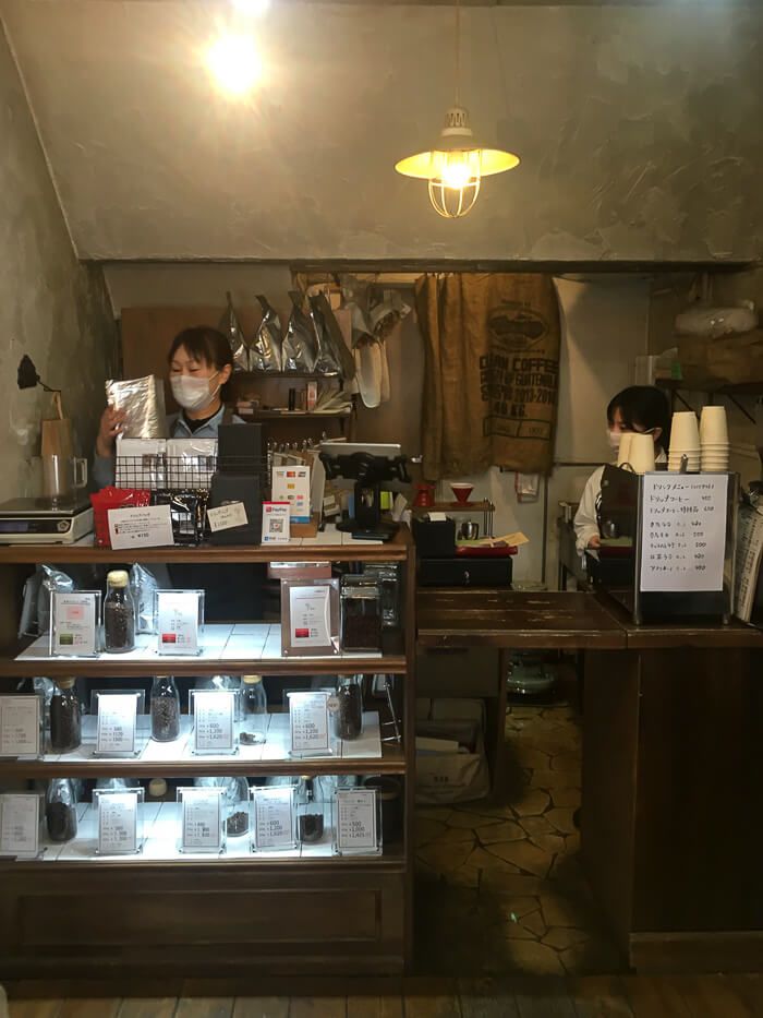 The team of Tailored Coffee preparing coffees behind the counter