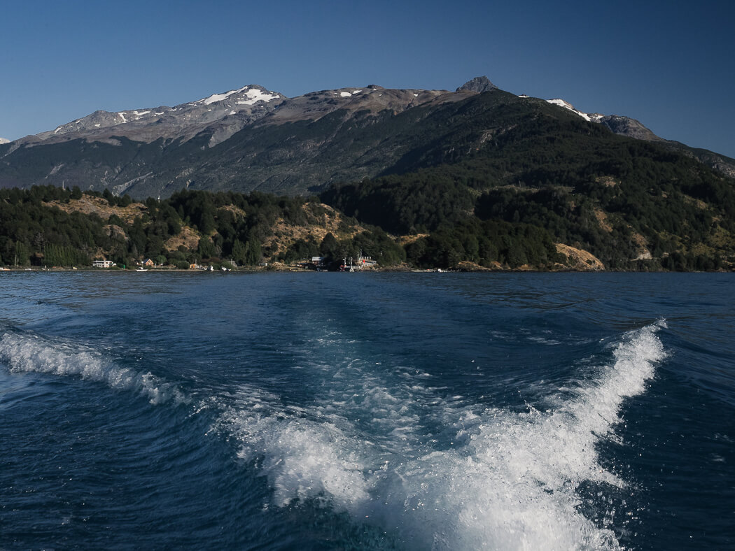 Speedboat pulling away from mainland in Patagonia