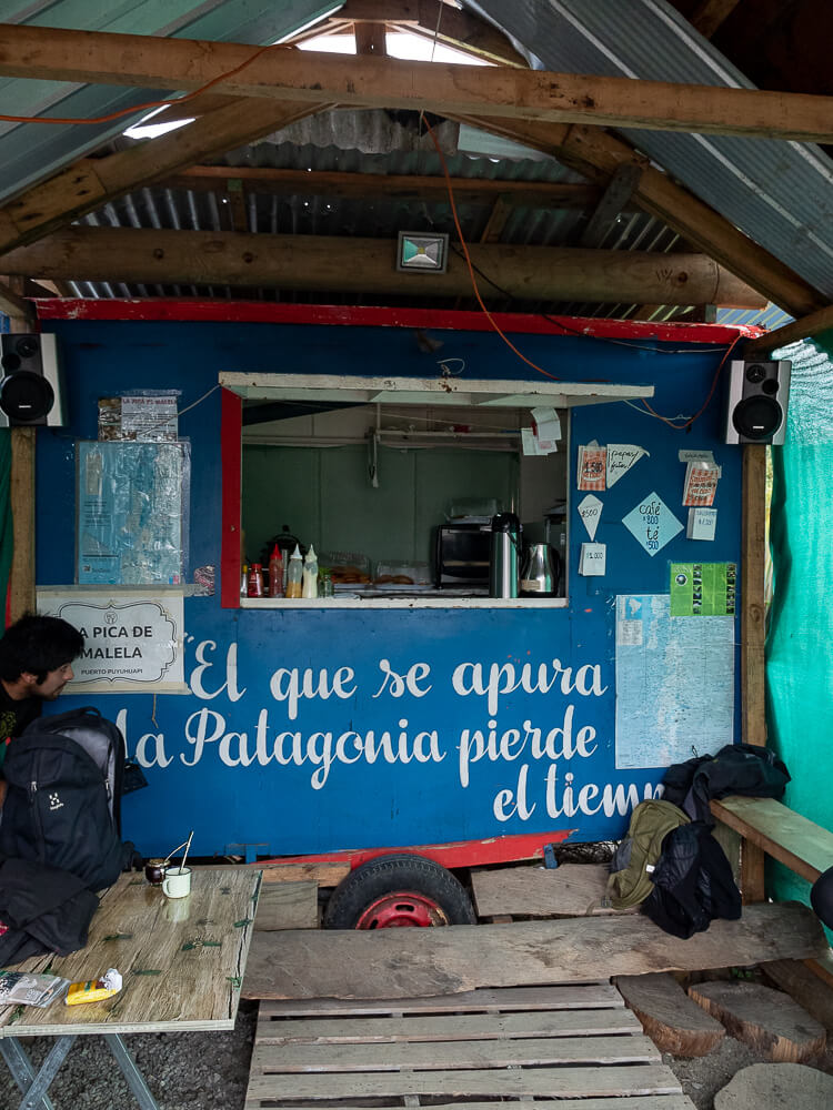 The inside of a food truck selling local food in Puyuhuapi