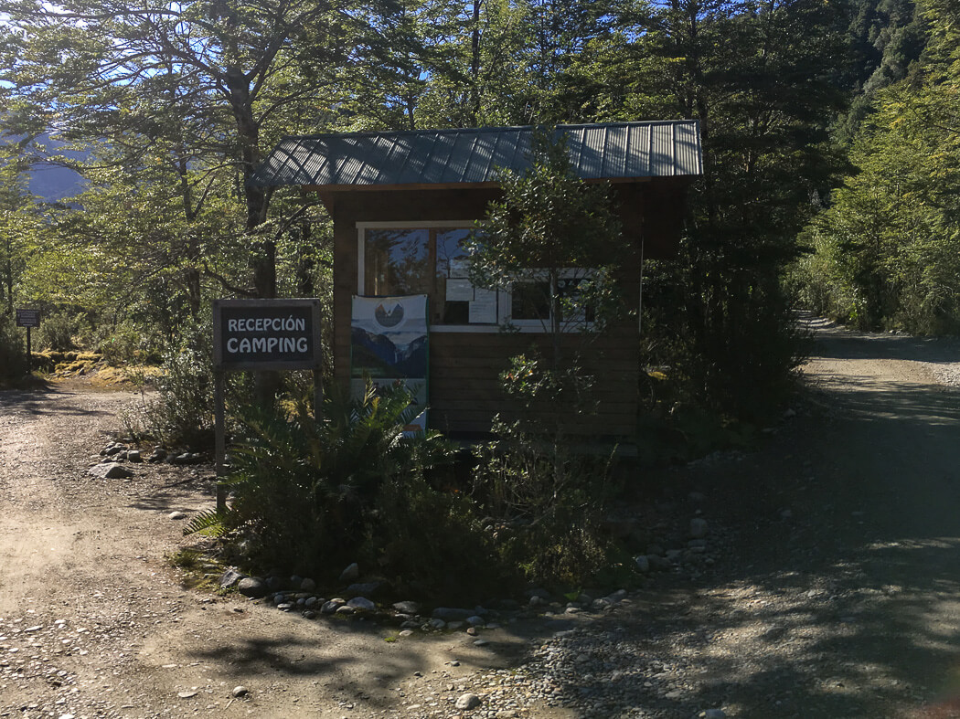 A ranger booth with a sign that reads 'recepcion camping' in Queulat National Park