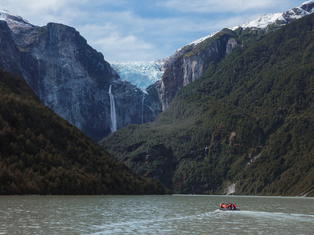 A boat heads out on the lagoon towards the hanging glacier, Chile