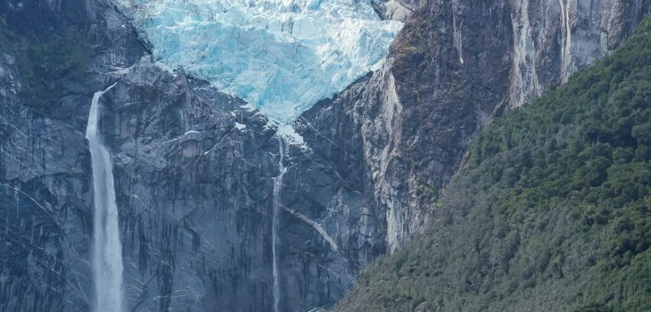 The hanging glacier in Chile and water falling into the lagoon below