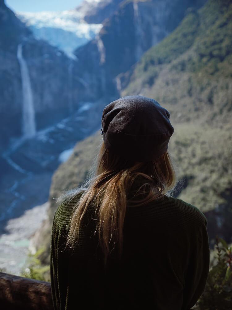 A girl looking towards Ventisquero Colgante from the famous mirador